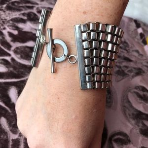 Chain link strand bracelet with toggle closure.